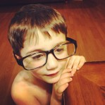 This child loves me so much and mimics every thing I do. He makes me be a better man. And he looks cute in my glasses.