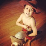 Working from home has it's advantages, like getting to see my boy ride his dinohorse through the house playing cowboy.