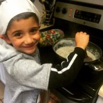 Aiden loves helping his daddy in the kitchen. We're making biscuits and gravy for the Copley house this morning. Love to all.